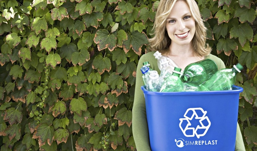 Woman with ivy and recycling bin